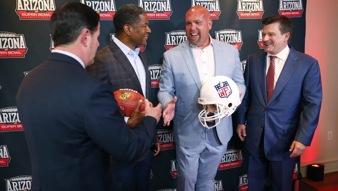 (From left) Arizona Gov. Doug Ducey, Arizona Cardinals head coach Steve Wilks, General Manager Steve Keim and team President Michael Bidwill shake hands after a press conference on Arizona's selection as the host for Super Bowl LVII in 2023, at the Sanctuary Resort in Scottsdale on May 23, 2018.