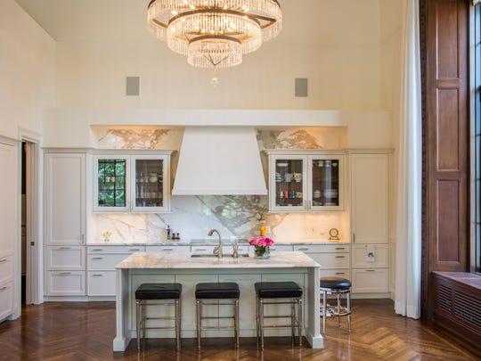The modernized kitchen has no visible refrigerator.