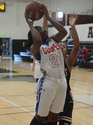 Cooper forward Daniece Edwards goes up for a shot against