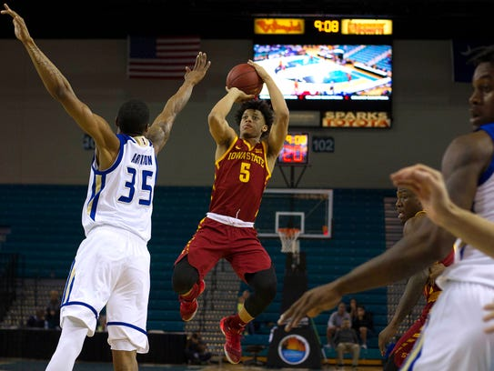 Iowa State Cyclones guard Lindell Wigginton (5) shoots the ball against the Tulsa Golden Hurricane on Friday. The Cyclones beat Tulsa to move to 2-0 in the Puerto Rico Tip-Off tournament.