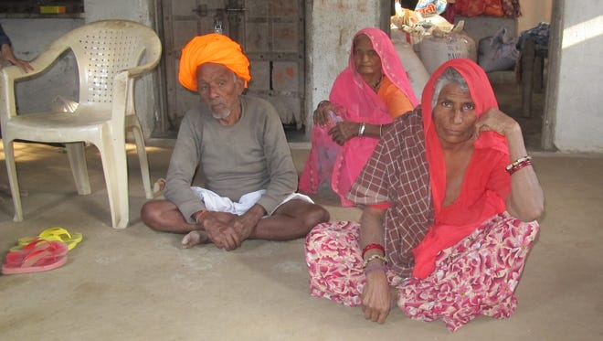 """Kanya Devi, 65, (right) was forced to stay hidden in a cell-like storage room in her home for nearly a month after a neighbor girl accused her of witchcraft. Like most women who are branded as witches, she belongs to one of the Dalit castes - formally known as """"Untouchables."""""""