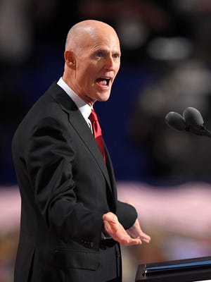 Florida Gov. Rick Scott speaks during the third day of the Republican National Convention in Cleveland, Wednesday, July 20, 2016. (AP Photo/Mark Terrill)