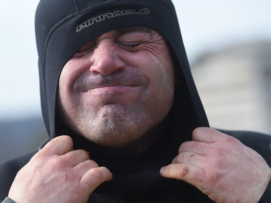 During the winter, Steve Goodley wears a skin suit, wet suit and dry suit while diving for golf balls in icy ponds. Goodley is one of the few who makes a living diving for golf balls year-round in the Northeast.