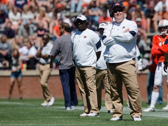 Auburn offensive line coach Herb Hand looks on during Auburn's A-Day on Saturday, April 8, 2017, at Jordan Hare Stadium in Auburn, Ala.