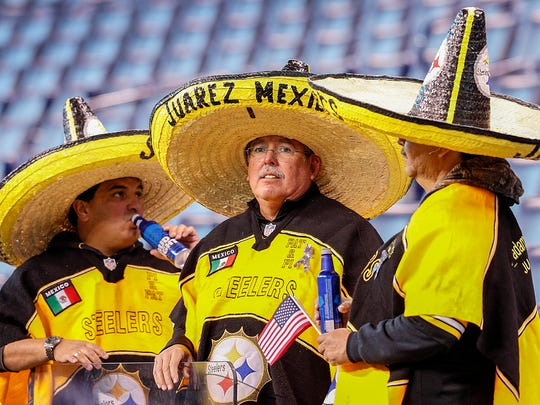 Pittsburgh Steelers fans from Juarez Mexico sport their yellow and black sombreros before the start of their game at Lucas Oil Stadium Sunday, Nov 12, 2017.