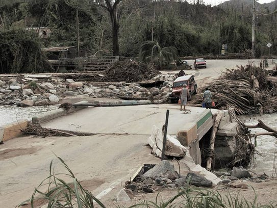 Roads and bridges were washed away by Hurricane Maria.
