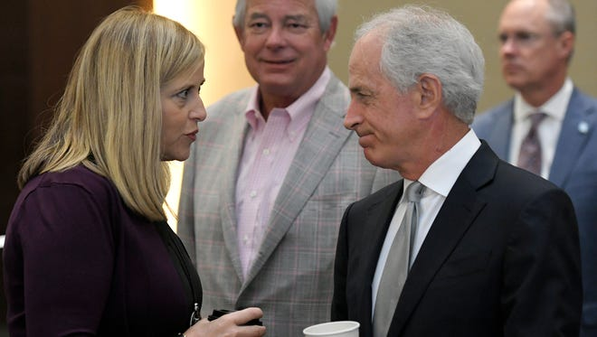 Mayor Megan Barry and Sen. Bob Corker greet each other before speaking at Operation Stand Down Tennessee's 7th Annual Heroes Breakfast at Omni Hotel in Nashville on Friday, August 18, 2017. .
