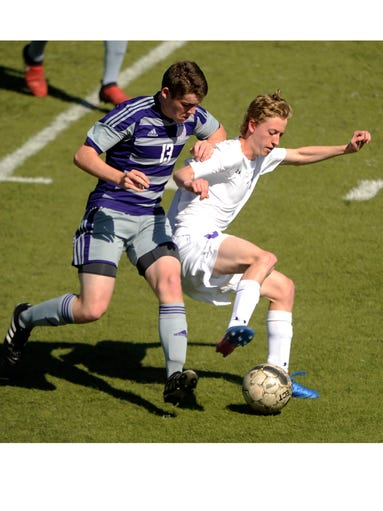 Wylie's Kyle Morris (6) steals the ball away from Boerne's