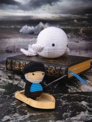 """Crochet characters from the literary classic """"Moby Dick"""" are featured in the book """"Literary Yarns: Crochet Projects Inspired by Classic Books"""" by Cindy Wang."""