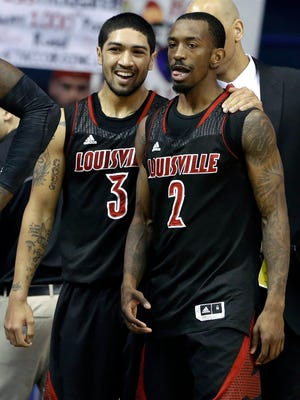 Louisville guard Peyton Siva, left, talks with guard Russ Smith after the Cardinals beat DePaul during their national championship season.