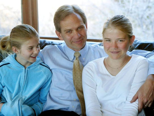 Ed Smart sits with daughters, Mary Katherine, left,