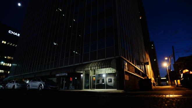 A single light illuminates the Beck Building along Edwards Street in downtown Shreveport.