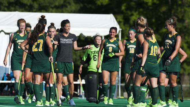 Vermont head coach Kate Pfeifer talks to the team during a time out during the women's field hockey game between the Holy Cross Crusaders and the Vermont Catamounts at Moulton Winder Field on Wednesday afternoon in Burlington.