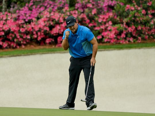 Patrick Reed reacts to his eagle on the 13th hole during the third round at the Masters golf tournament Saturday, April 7, 2018, in Augusta, Ga. (AP Photo/David J. Phillip)