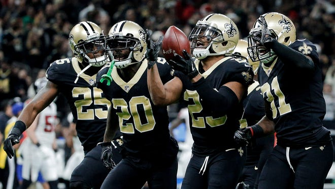 New Orleans Saints cornerback Marshon Lattimore (23) celebrates with teammates after a interception against the Atlanta Falcons during the second quarter at the Mercedes-Benz Superdome.
