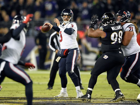 Houston Texans quarterback Tom Savage (3) throws to a receiver in the first half of an NFL football game against the Baltimore Ravens, Monday, Nov. 27, 2017, in Baltimore. (AP Photo/Nick Wass)