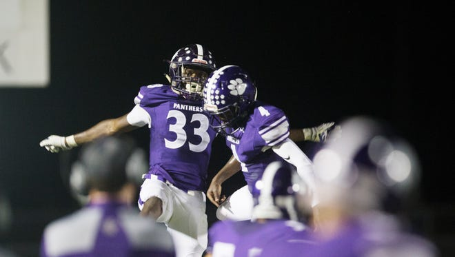 Cypress Lake High School's Chris Joseph celebrates scoring a touchdown against Mariner on Friday at Cypress Lake in Fort Myers. Cypress beat Mariner 44-34.