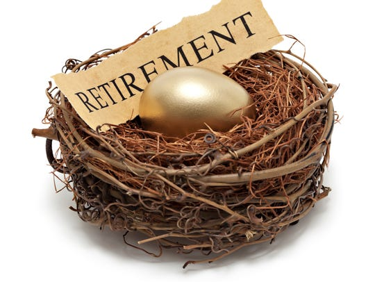 Golden nest egg in bird's nest with the word retirement