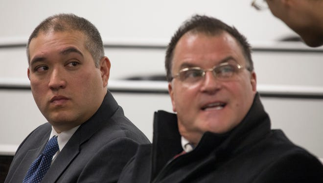EX-MSP trooper Mark Bessner,left, sits with his attorney Richard Convertino before he was arraigned Thursday Dec. 21, 2017 in the death of a 15-year-old riding on an atv by Magistrate Bari Blake Wood in 36th District Court in Detroit.