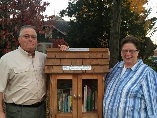 Mary Ann and Tony Piccioni in front of their little library in Glendora.