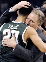 MSU head coach Tom Izzo hugs senior guard Travis Trice