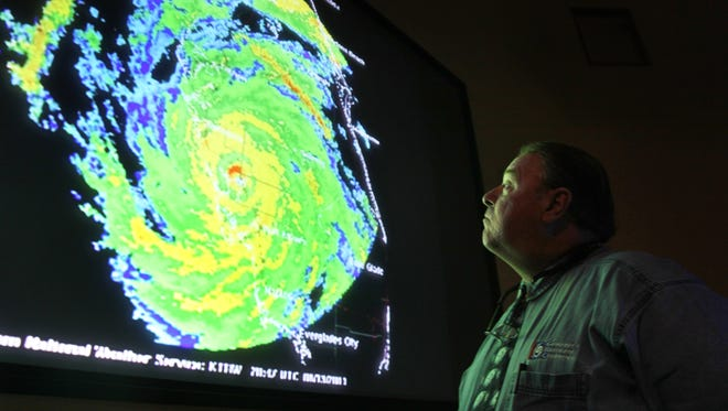 Charlotte County Emergency Management Director Wayne Sallade looks at a radar image of Hurricane Charley in Charlotte County's new public safety building that was constructed after the storm.