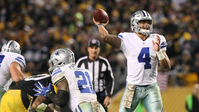 Dallas Cowboys quarterback Dak Prescott (4) throws a pass against the Pittsburgh Steelers during the second half of their game at Heinz Field. The Cowboys won the game, 35-30.