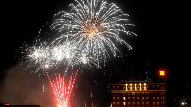 Fireworks light up the sky near the Tiger Hotel during the 2017 Fire in the Sky celebration.