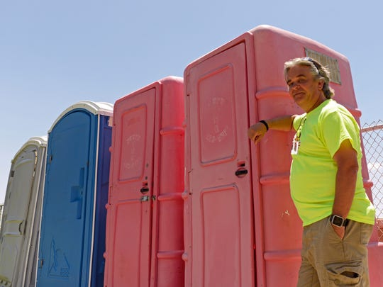 Steve Hanson, vice president of the Las Cruces Youth Soccer League, stands in front of the portable toilets at Provencio/Van Dame soccer complex.