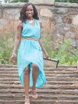 Tishena Moss wears a Kenneth Cole New York dress.