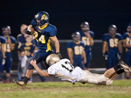 Eastern York's Alex Cooley (24) shakes off Delone Catholic's Brett Smith (12) for a 58-yard touchdown catch on Oct. 26. FOR THE DAILY RECORD/SUNDAY NEWS -- JEFF LAUTENBERGER