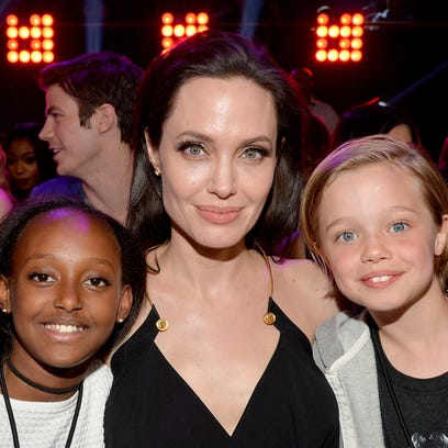 INGLEWOOD, CA - MARCH 28:  Actress Angelina Jolie hugs Zahara Marley Jolie-Pitt (L) and Shiloh Nouvel Jolie-Pitt (R) after winning award for Favorite Villain in 'Maleficent' during Nickelodeon's 28th Annual Kids' Choice Awards held at The Forum on March 28, 2015 in Inglewood, California.  (Photo by Kevin Winter/Getty Images) ORG XMIT: 543521891 ORIG FILE ID: 467961600