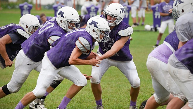 Albany runs their offense during practice Monday, Aug. 21, in Albany.