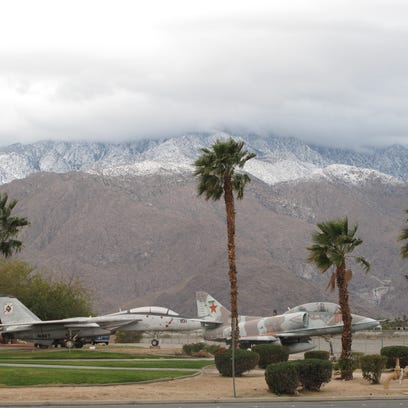 Snow is seen in mountains surrounding the Coachella