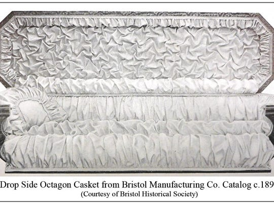 A drop side octogon casket made by the Bristol Manufacturing