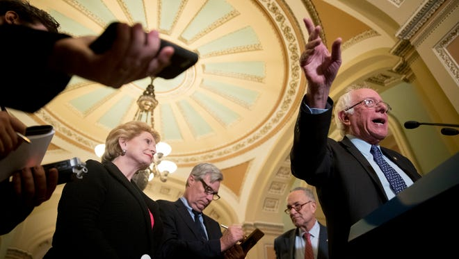 Sen. Bernie Sanders, I-Vt., speaks to reporters on Capitol Hill on Oct. 17, 2017, following Senate policy luncheons.