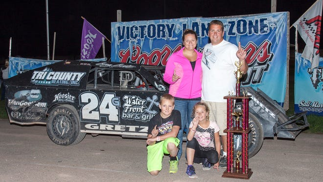 Kewaunee's Greg Gretz poses in victory lane after winning the IMCA modified Track championship at Thunder Hill Raceway in 2015. With Door County putting the  track's weekly operation out for bids, the future of the third-mile clay oval at John Miles Park is in question.
