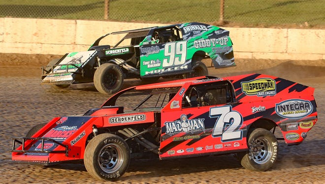 Seymour's Brian Mullen (72) races door-to-door with his son Mike Mullen (99) in IMCA modified action. Brian Mullen has a total of 156 career modified wins heading into this weekend.