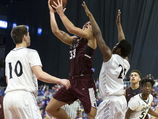 Bowie's Daniel Mosley (33) looks to score over Grandview's