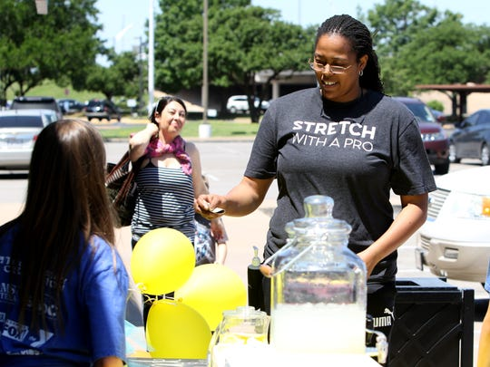 Thomeisha TC Carter buys lemonade during Lemonade Day Saturday, May 5, 2018, in Parker Square.