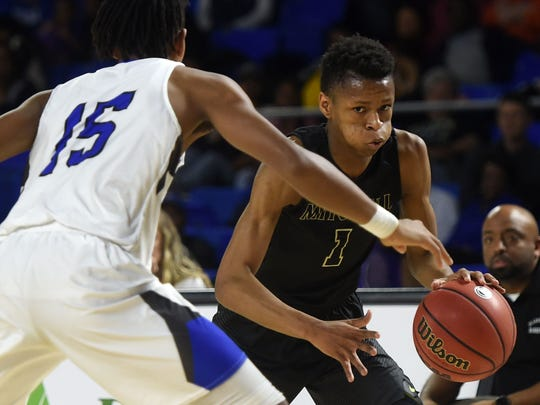 Mitchell's Mohanna Sanders (1) dribbles the ball while defended by Harriman's Isaiah McClain (15) during a quarterfinal Division I class A boys' basketball game between Harriman and Mitchell at Middle Tennessee State University on Thursday, March 16, 2017.