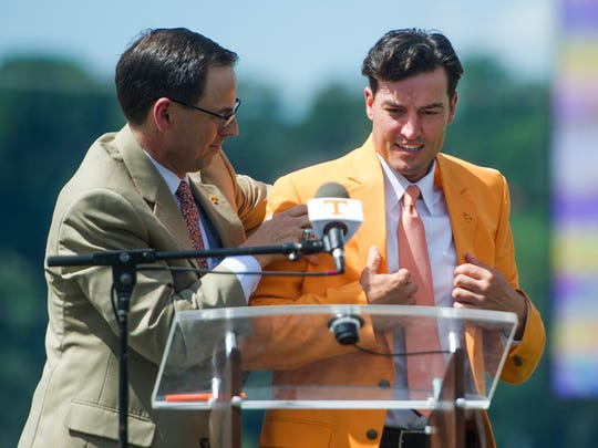 At left John Currie, Tennessee vice chancellor and director of athletics helps new University of Tennessee Baseball Head Coach Tony Vitello put on an orange blazer at a press conference introducing him to the media, at Lindsey Nelson Stadium on Friday June 9, 2017.