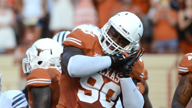 Texas Longhorns defensive tackle Hassan Ridgeway (98) reacts after a sack against the Brigham Young Cougars during the first half at Darrell K Royal-Texas Memorial Stadium.