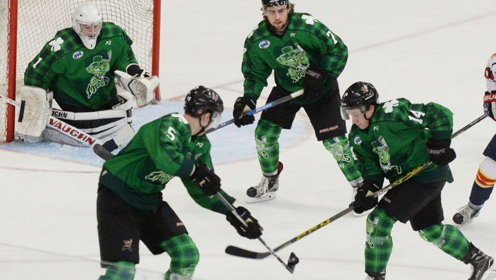 Mudbugs defensemen Croix Evingson (5), Brendon Gysbers (7) and forward Gueorgui Feduolov and help protect the net for goaltender John Roberts.