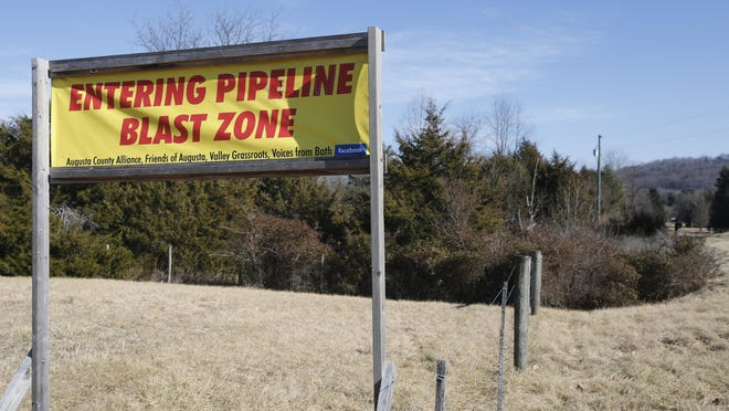 This Feb. 8, 2018 photo shows a sign along a highway to protests the route of the Atlantic Coast Pipeline in Deerfield, Va. The developers of the Atlantic Coast Pipeline announced Sunday that they are canceling the multi-state natural gas project, citing delays and increasing cost uncertainty.