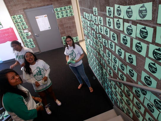 Students decorate a hallway Friday at Farmington High