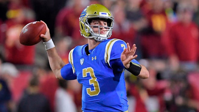 FILE - In this Nov. 18, 2017, file photo, UCLA quarterback Josh Rosen passes during the first half of an NCAA college football game against Southern California in Los Angeles. Every quarterback prospect in the upcoming NFL draft has a major flaw or drawback that keeps them from being the consensus best one of the bunch. (AP Photo/Mark J. Terrill, File)
