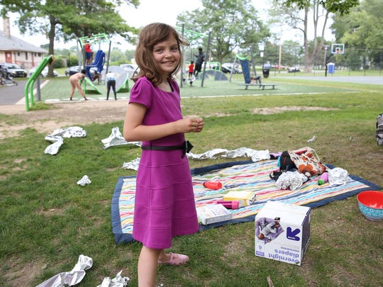 Ada Woodworth, 8, prepared for the solar eclipse by building safe viewers and bringing along tin foil alien hats for her friends and family.