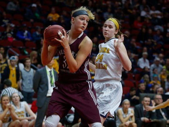 Western Christian junior Ashtyn Veerbeek controls possession of the ball as she is pressed by Regina sophomore Alex Wiese during the Iowa high school girls state basketball tournament on Thursday, March 2, 2017, at Wells Fargo Arena in Des Moines.