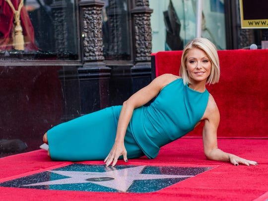 Television host Kelly Ripa poses with her star on the
